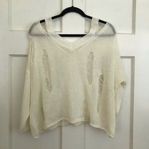 Distressed off shoulder cream knit top